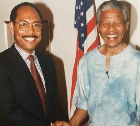 マイケル(左)とネルソン・マンデラ氏